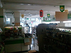 darkened convenience store to save electricity