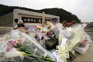 Flowers and tributes in front of Okawa Elementary School in Ishinomaki