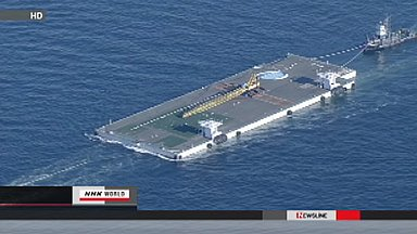 Massive floating platform heads for Fukushima