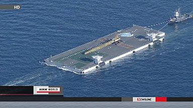 Massive floating platform heads for Fukushima
