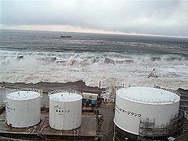 TEPCO releases photos of tsunami hitting plant