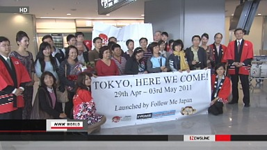 Tourists return to Tokyo