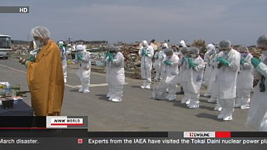 Families of tsunami victims visit no-entry zone