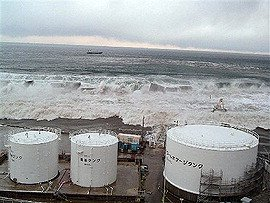 TEPCO releases photos of tsunami hitting plant