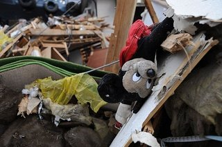 Mickey Mouse doll lies among debris in Ofunato