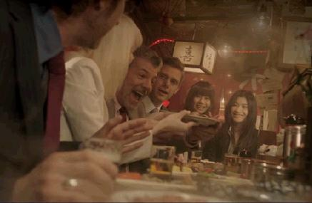 American businessman eating oden at Japanese yatai
