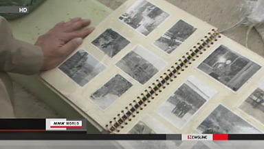 Volunteers clean photos found in Japan tsunami debris