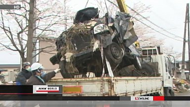 Wrecked cars removed from Sendai residential area