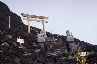Torii gate & guardian Shisa lions near Mt. Fuji summit