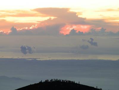 Hikers awaiting sunrise on the eastern rim of the caldera